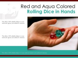 Red And Aqua Colored Rolling Dice In Hands