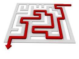 Red Arrow For Solution Path In Maze Stock Photo