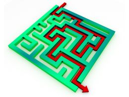 Red Arrow For Way Out From Green Maze Stock Photo