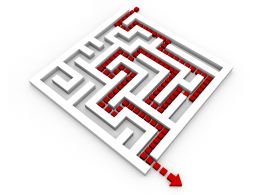 Red Arrow Showing Solution Path Inside The Maze Stock Photo