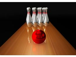 Red Ball And Silver Pins Of Bowling Game Stock Photo