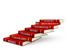 Red Books In Stacks With Different Subject Text Stock Photo