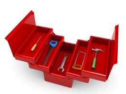 Red Colored Tool Box With Hammer Wrench And Spanner Stock Photo