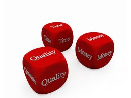 Red Cubes Of With Time Money And Quality Terms Stock Photo