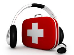 Red First Aid Box With Head Phone Stock Photo