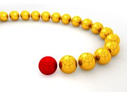 Red Glossy Sphere Ahead Of Yellow Spheres For Leadership Stock Photo