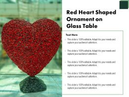 Red Heart Shaped Ornament On Glass Table
