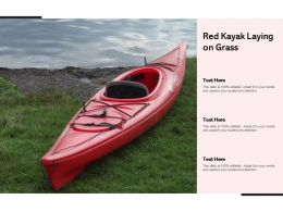 Red Kayak Laying On Grass