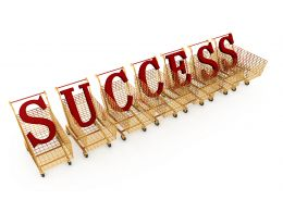 Red Letters Of Success In Shopping Carts Stock Photo