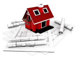 Red Model Of House With Construction Maps For Architecture Stock Photo