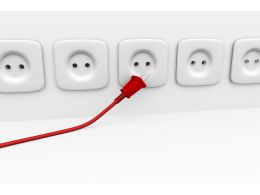 Red Plug With Multiple White Plugs To Show Options Available In Business Stock Photo