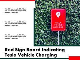 Red Sign Board Indicating Tesla Vehicle Charging