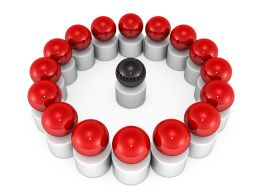 Red Spheres In Circle With One Black Sphere As Leader Stock Photo