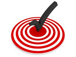 Red Target Dart With Tick Mark In Middle Stock Photo