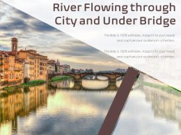River Flowing Through City And Under Bridge