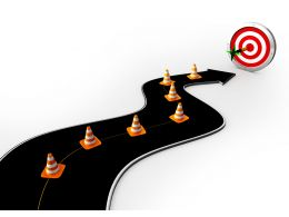 Road With Traffic Cones Reaching On Target Stock Photo