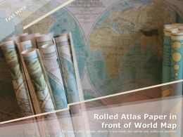 Rolled Atlas Paper In Front Of World Map