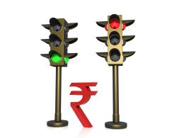 Rupee Currency Between Two Light Signals Stock Photo