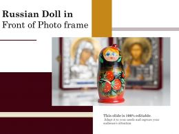 Russian Doll In Front Of Photo Frame