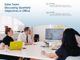 Sales Team Discussing Quarterly Objectives In Office