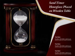 Sand Timer Hourglass Placed On Wooden Table