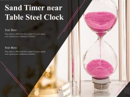 Sand Timer Near Table Steel Clock