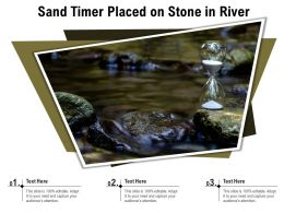Sand Timer Placed On Stone In River