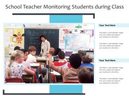 School Teacher Monitoring Students During Class