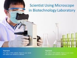Scientist Using Microscope In Biotechnology Laboratory
