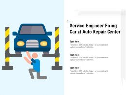 Service Engineer Fixing Car At Auto Repair Center
