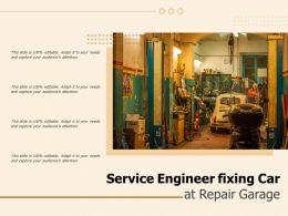 Service Engineer Fixing Car At Repair Garage