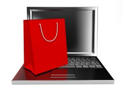 Shopping Bags In Red Color And Laptop Stock Photo