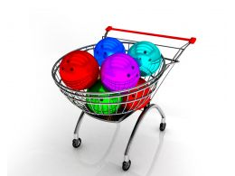 Shopping Cart Full With Colored Balls Stock Photo
