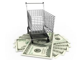 Shopping Cart With Dollars Below The Cart Stock Photo