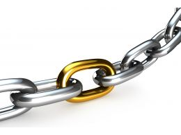Silver Chain With Golden Link In Middle Stock Photo