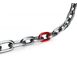 Silver Chain With Red Colored Link In The Middle Stock Photo