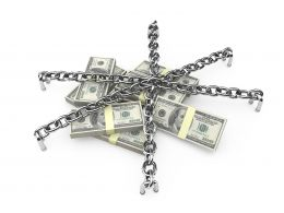 Silver Chains And Lock On Dollars Stock Photo