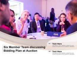Six Member Team Discussing Bidding Plan At Auction