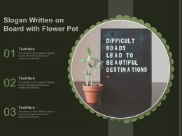 Slogan Written On Board With Flower Pot