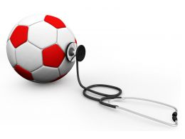 Soccer Football With Stethoscope Isolated On White Background Stock Photo