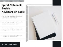 Spiral Notebook Beside Keyboard On Table