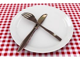 Spoon And Fork On Plate Over The Table Shows Food Stock Photo