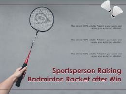 Sportsperson Raising Badminton Racket After Win