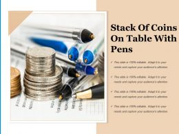 Stack Of Coins On Table With Pens