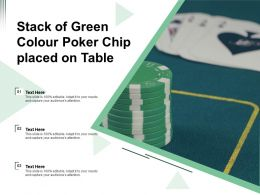 Stack Of Green Colour Poker Chip Placed On Table