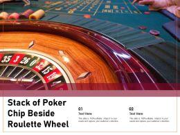 Stack Of Poker Chip Beside Roulette Wheel
