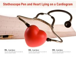 Stethoscope Pen And Heart Lying On A Cardiogram