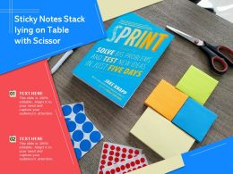 Sticky Notes Stack Lying On Table With Scissor