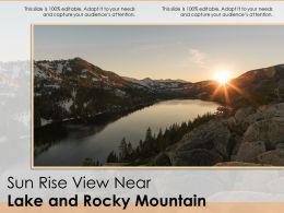 Sun Rise View Near Lake And Rocky Mountain