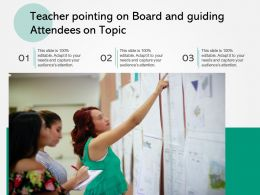 Teacher Pointing On Board And Guiding Attendees On Topic